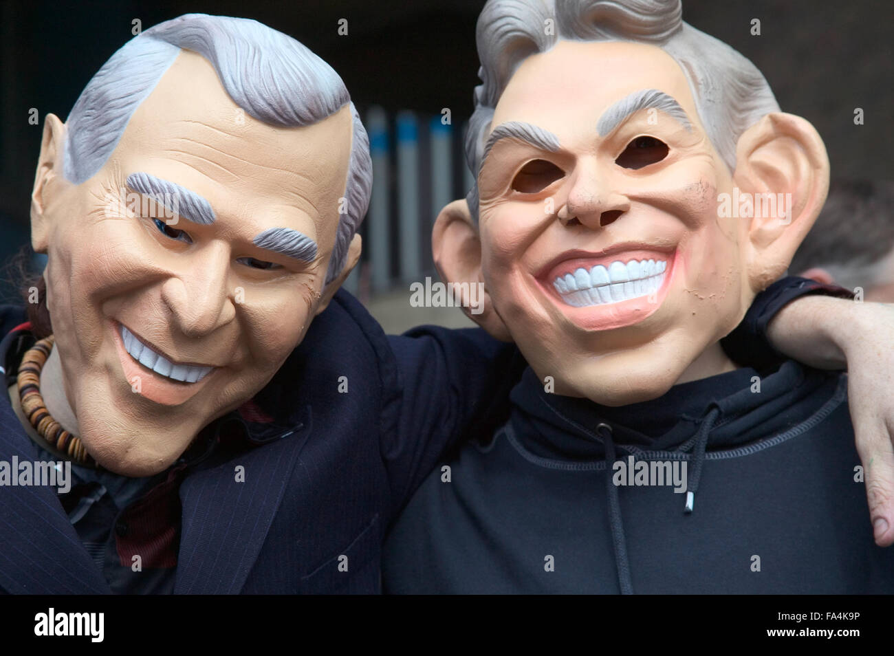 Friends of the Earth supporters wearing masks representing political leaders during protest, - Stock Image