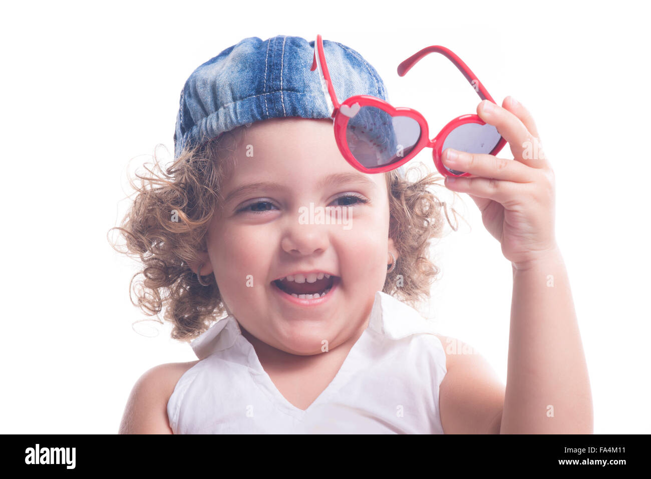 Isolated smiling female child with red sun glasses and blue hat - Stock  Image 96051895d738