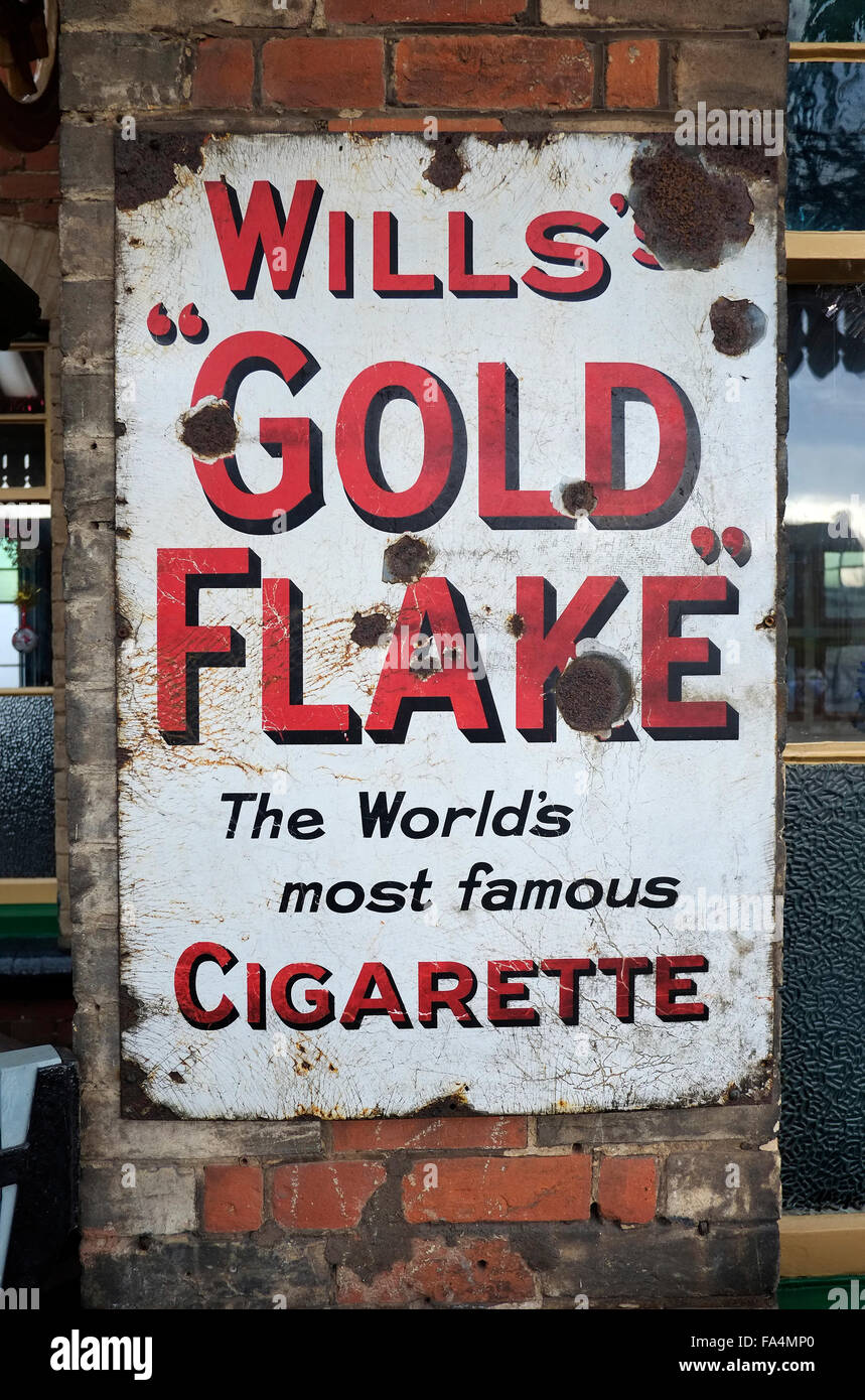 old metal wills gold flake cigarette advertisement - Stock Image
