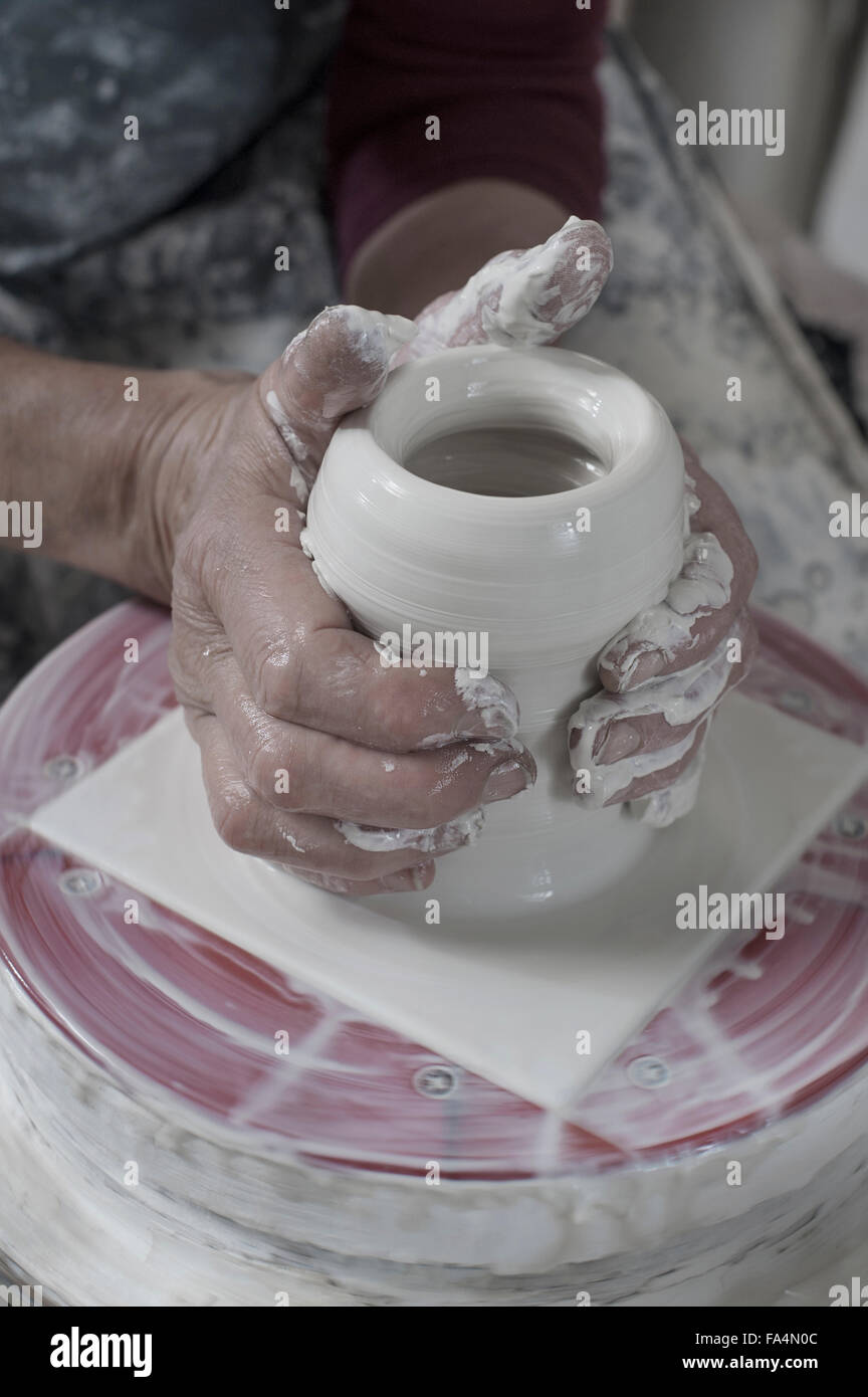 Close-up of female potter moulding clay in workshop, Bavaria, Germany - Stock Image