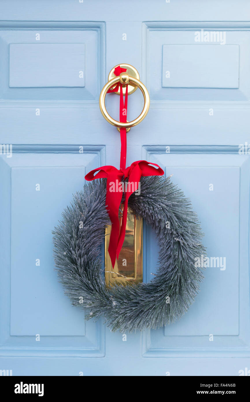 Christmas Wreath On A Pale Blue Wooden Door