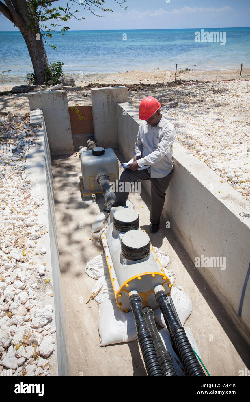 Under-sea power cable emerging on shores of Zanzibar from mainland, Tanzania, East Africa. - Stock Image