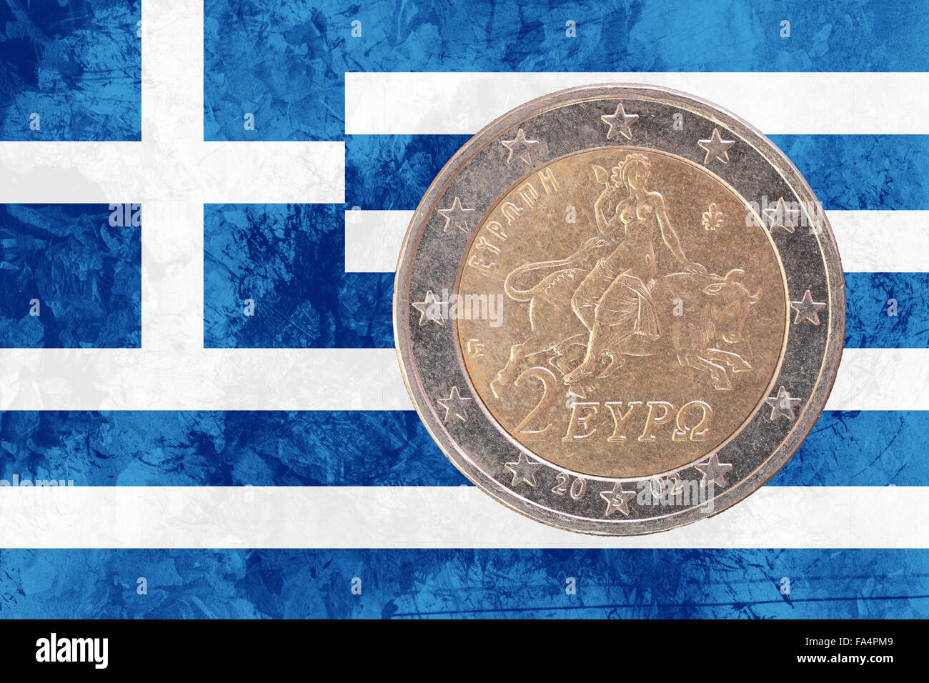 Two euros coin from Greece isolated on the national greek flag as background - Stock Image