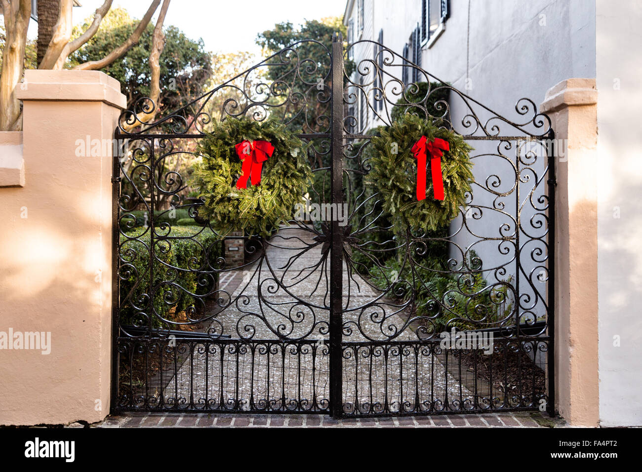 wrought iron gate on a traditional home along church street decorated with a christmas wreath for