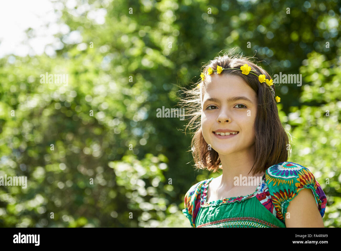 Portrait of a girl smiling in park, Munich, Bavaria, Germany - Stock Image
