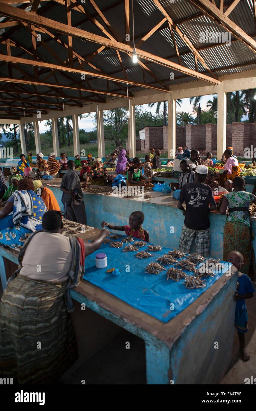 A nighttime market is lit by solar power in Msimba village, Kigoma Region, Western Tanzania. - Stock Image