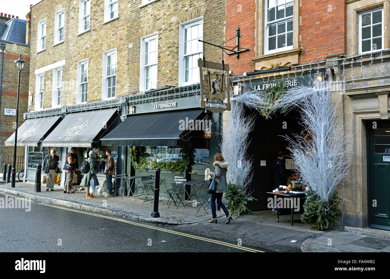 Shops including La Fromagerie and people Moxon Street Marylebone London England Britain UK - Stock Image