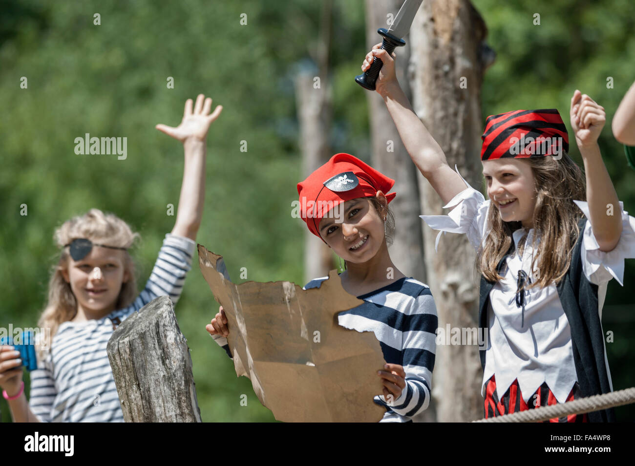 Girls playing on pirate ship in adventure playground, Bavaria, Germany - Stock Image