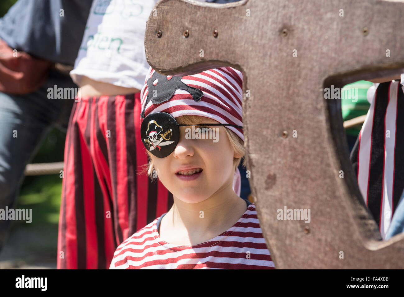 Boy dressed up as pirate in playground, Bavaria, Germany - Stock Image