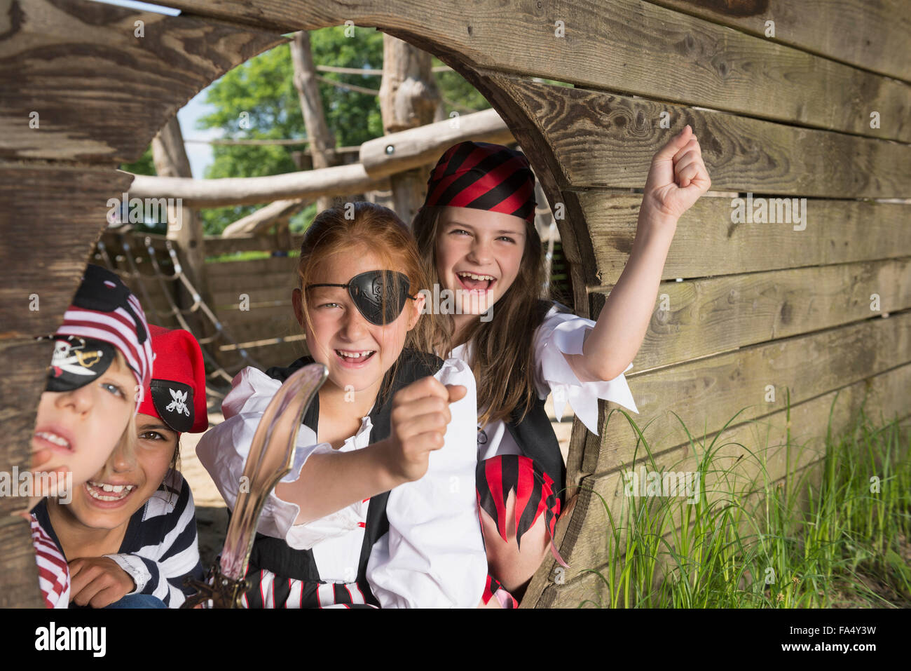 children playing on a pirate ship in adventure playground, Bavaria, Germany Stock Photo