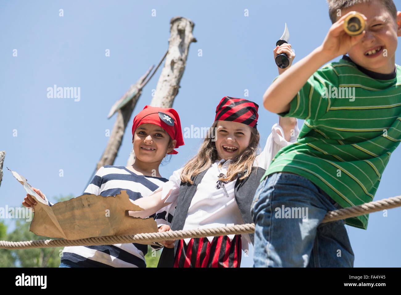 Children playing pirate game in adventure playground, Bavaria, Germany - Stock Image