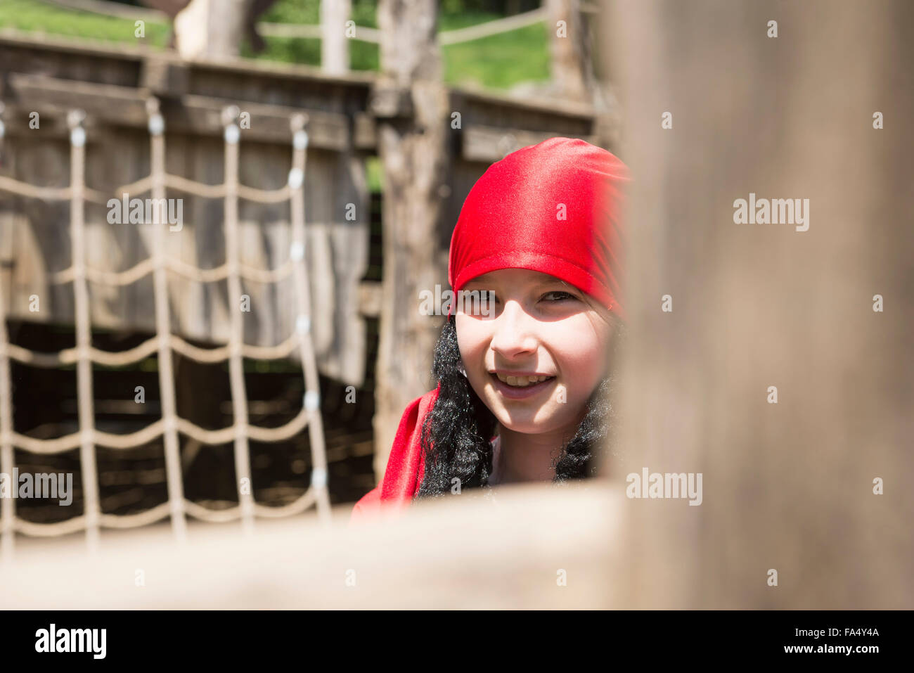 Portrait of a girl smiling in playground, Bavaria, Germany - Stock Image