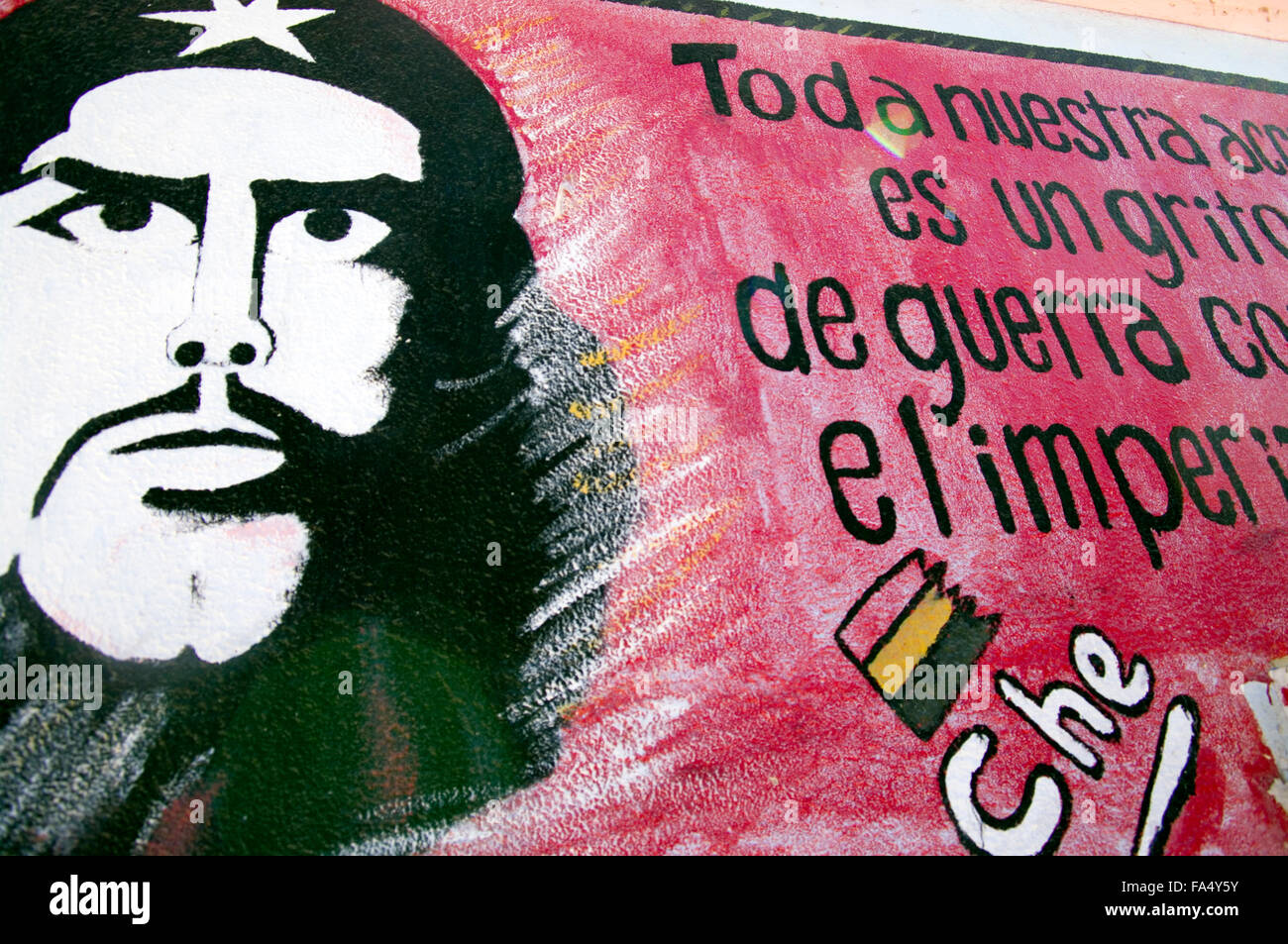 A school in Luribay, Bolivia, South America with Che Guevara hand painted in black against a red frame on the side - Stock Image
