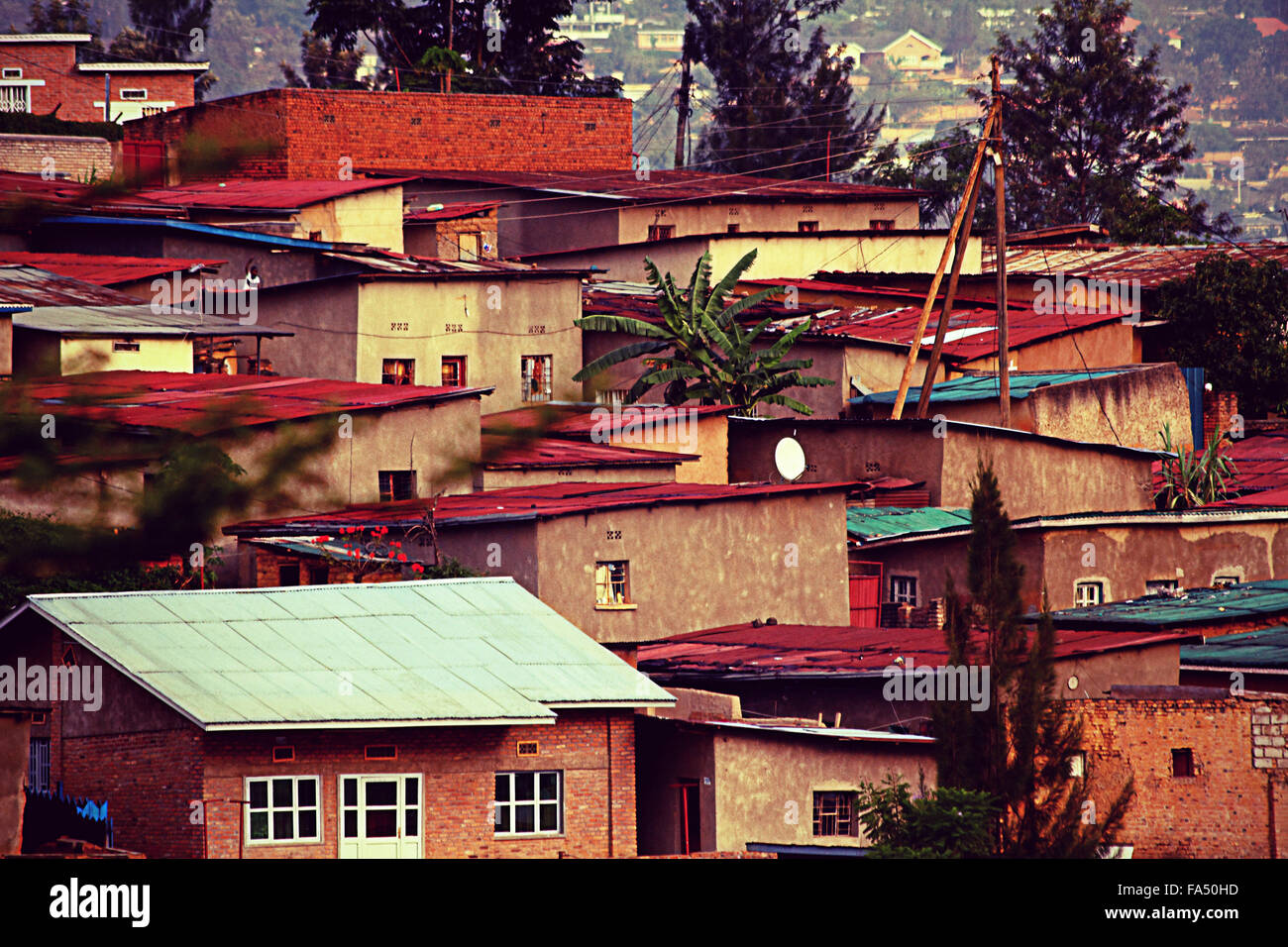 Colorful hillside homes in Kigali, Rwanda retro filter - Stock Image