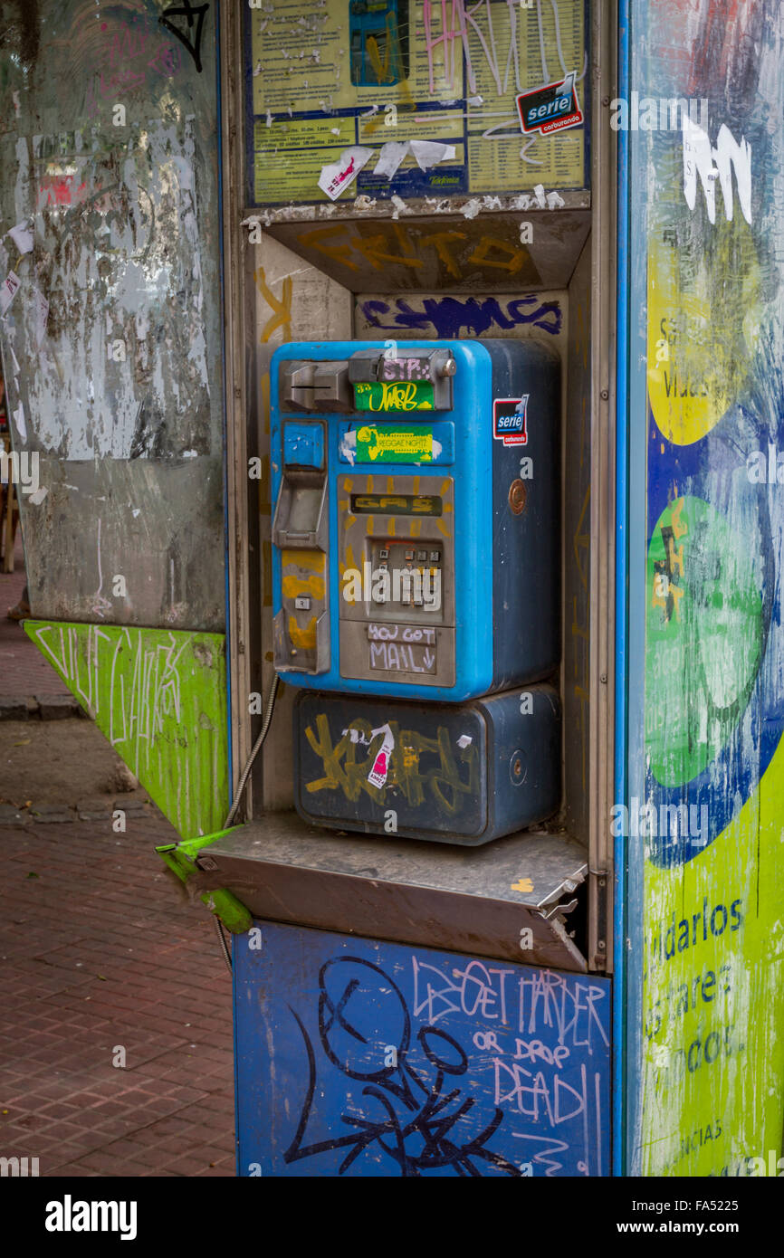Vandalism and graffiti on a telephone in Buenos Aires, Argentina - Stock Image