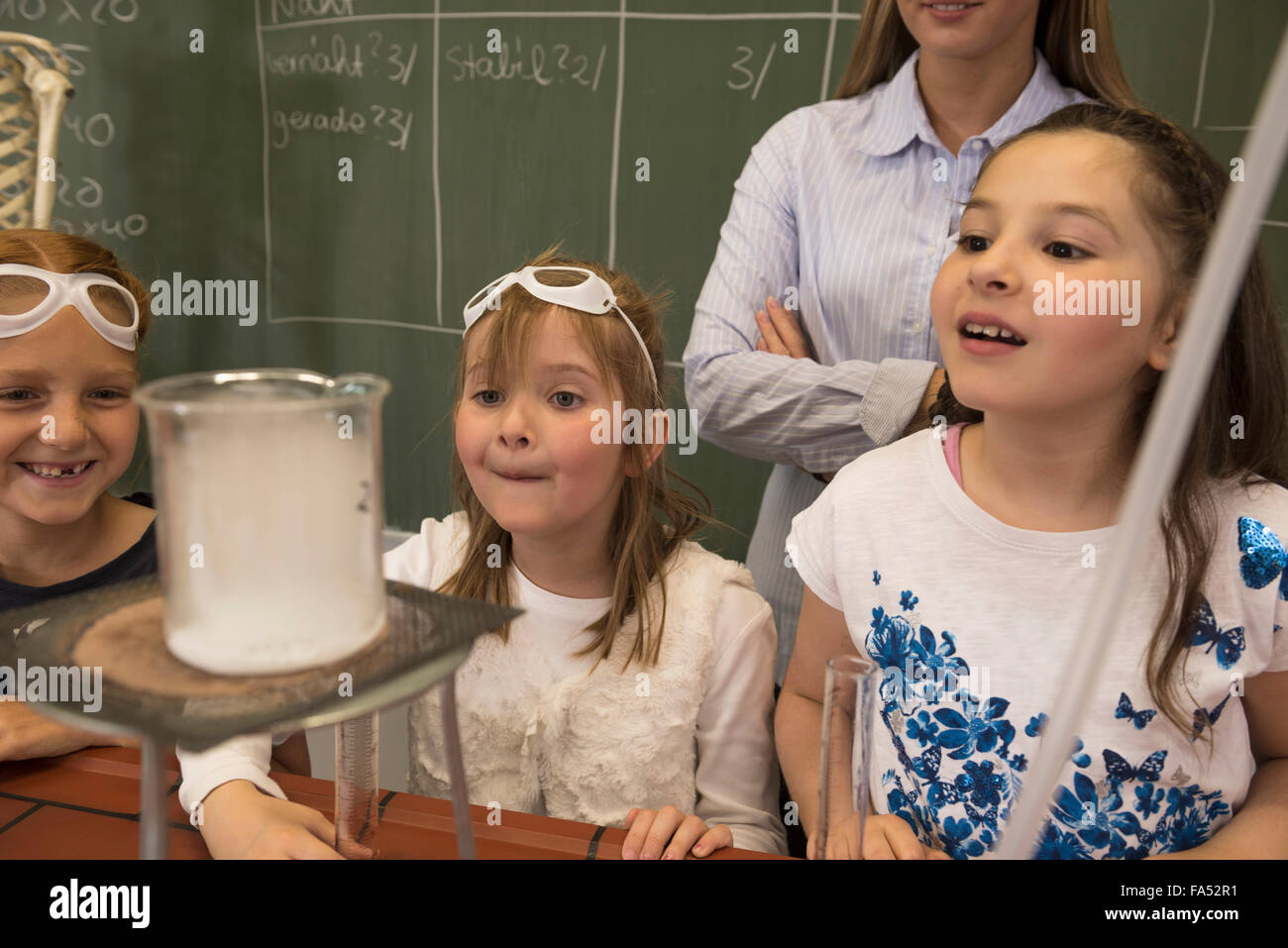 Teacher and school girls conducting scientific experiments, Fürstenfeldbruck, Bavaria, Germany - Stock Image