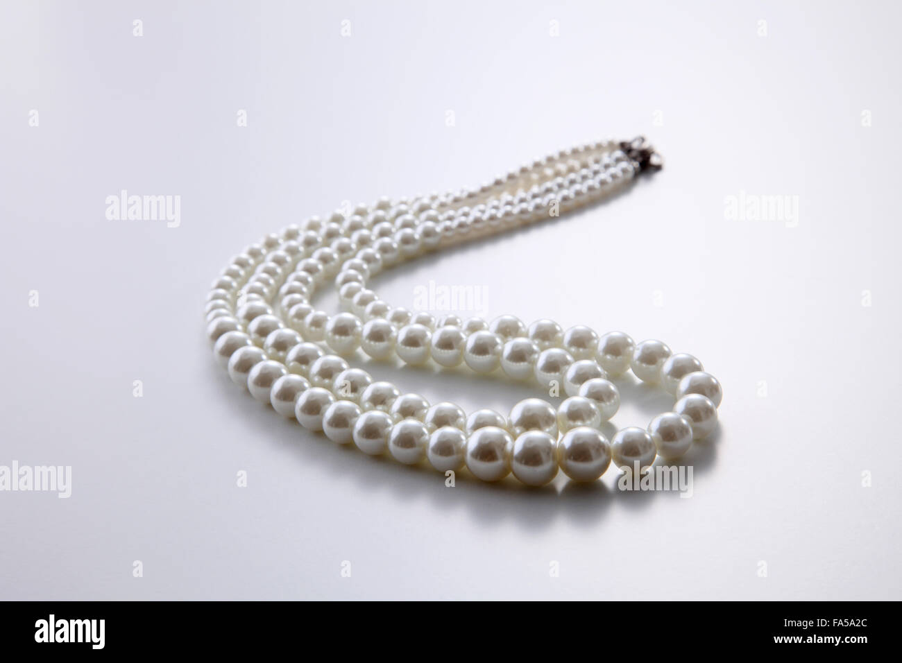 676ad62ba08aac pearls necklace on the white background Stock Photo: 92316068 - Alamy