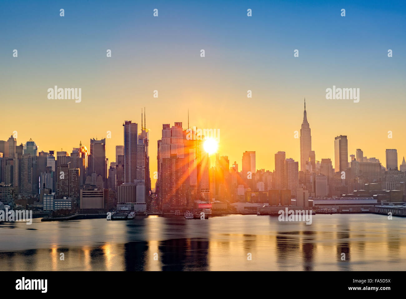 Midtown Manhattan skyline at sunrise, as viewed from Weehawken, along the 42nd street canyon Stock Photo