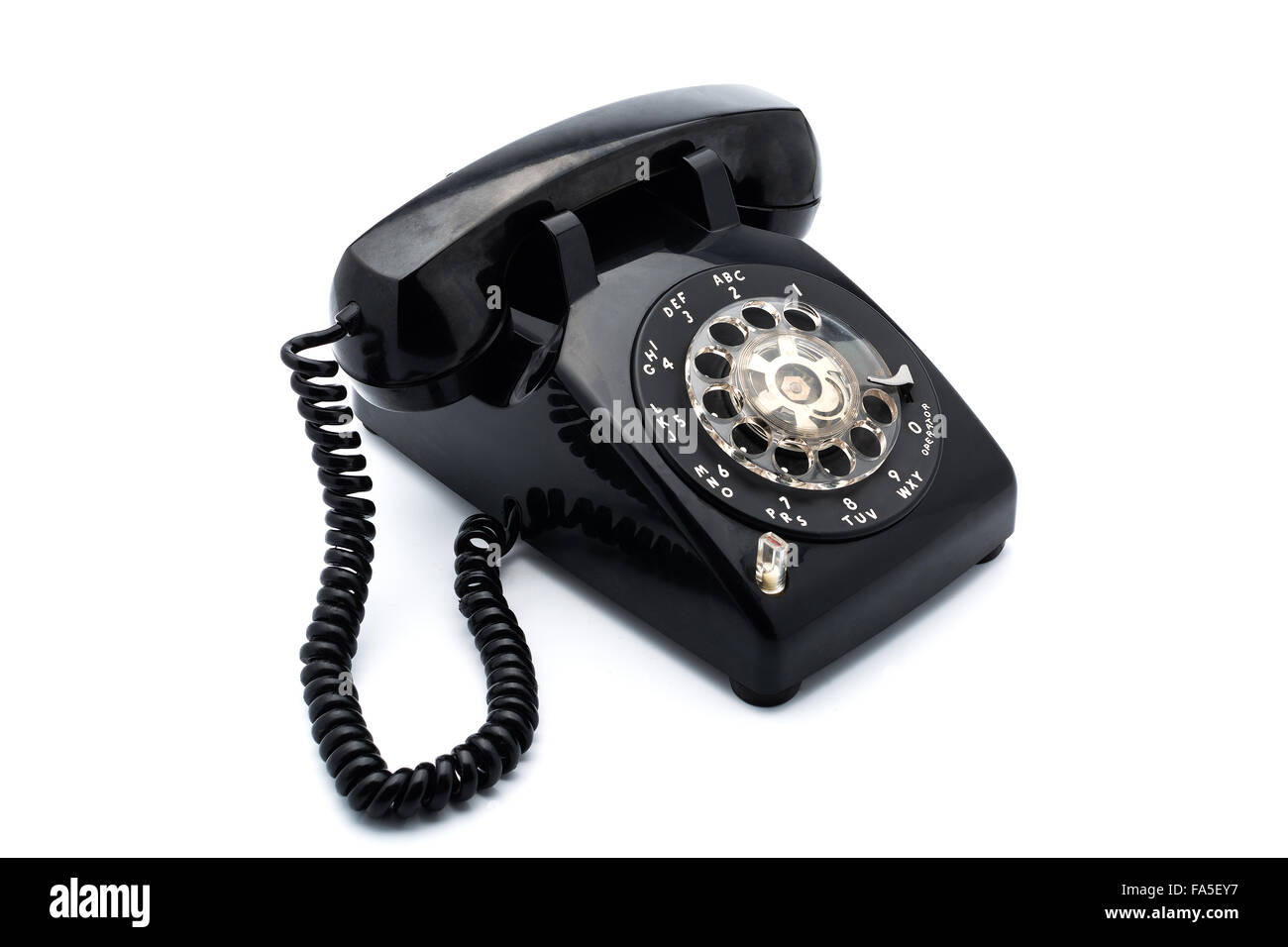 Black old telephon with rotary dial on white background - Stock Image