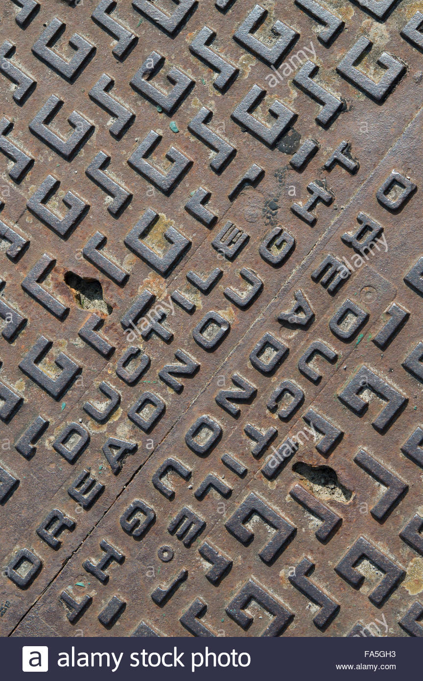 Close-up of a Ductile Dreadnought manhole cover - Stock Image