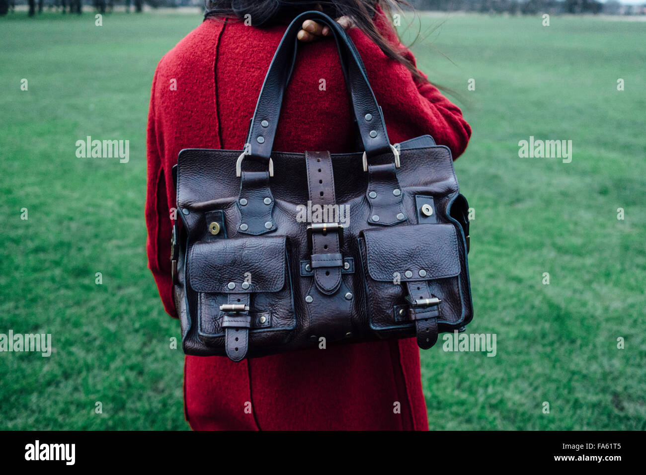 551f06926cc2 Mulberry handbag in black patent shiny soft leather. BWMMDH (RM). Woman  holding Mulberry Roxanne leather handbag over the shoulder - Stock Image
