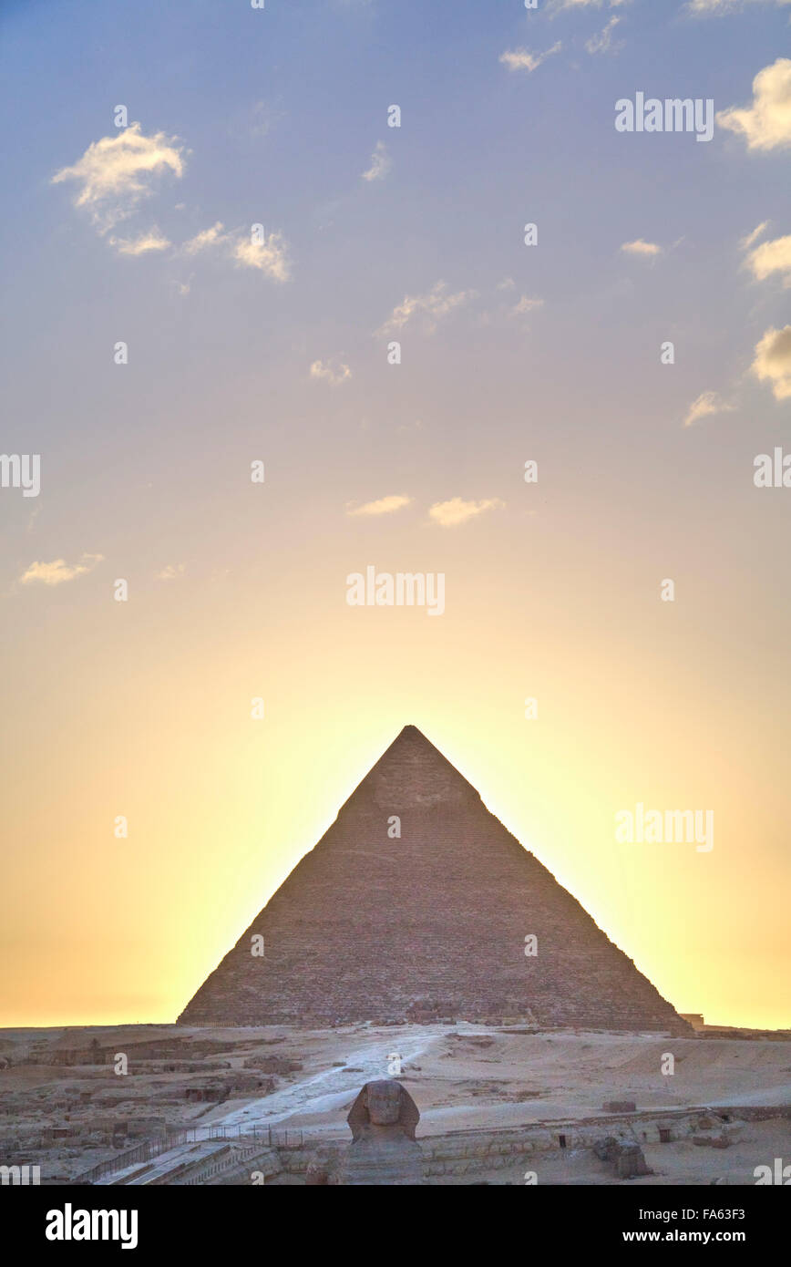 Sunset, Sphinx (foreground), The Pyramid of Chephren (background), The Pyramids of Giza, UNESCO World Heritage Site, - Stock Image