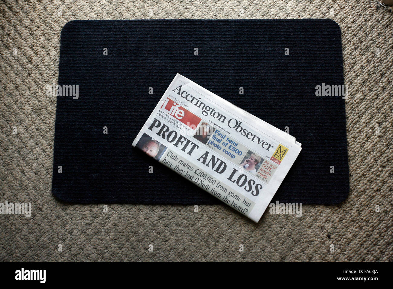 Accrington Observer newspaper on a doormat - Stock Image