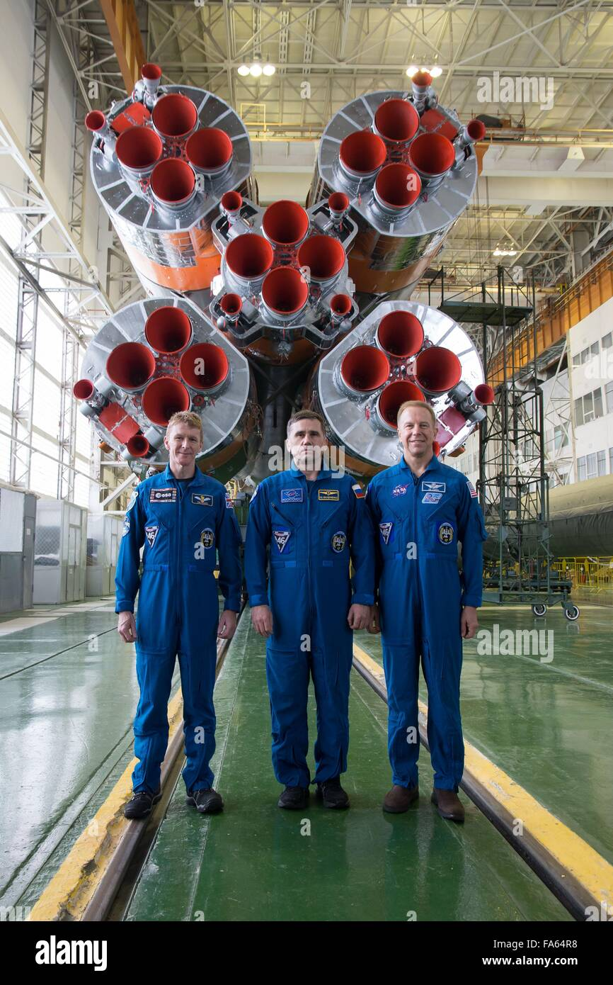 International Space Station Expedition 46 crew pose for a photo in front of the first stage of the Soyuz booster - Stock Image
