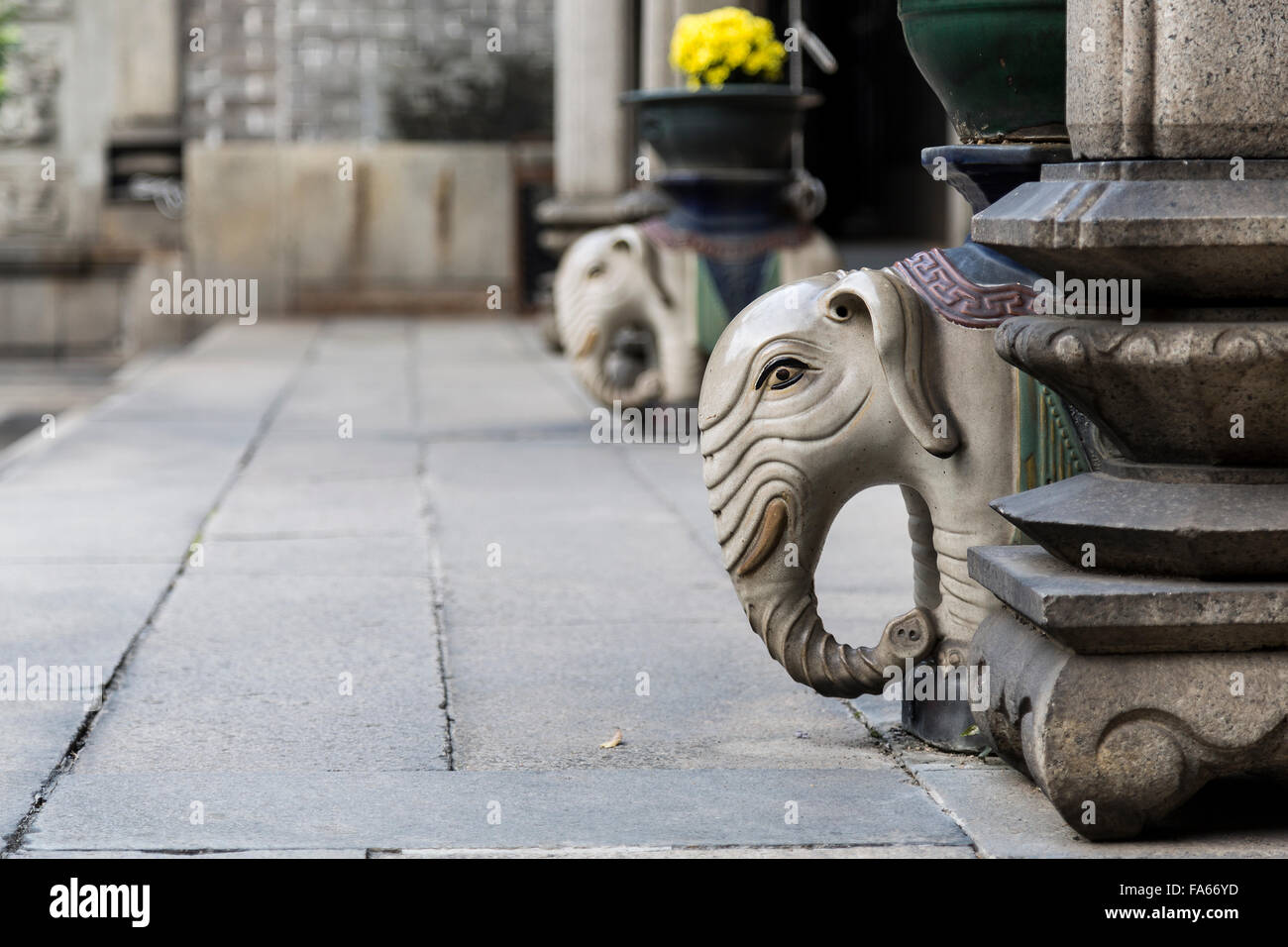 Elephant sculptures decorating the corridors of the Museum of Folk Art, Guangzhou, China. - Stock Image