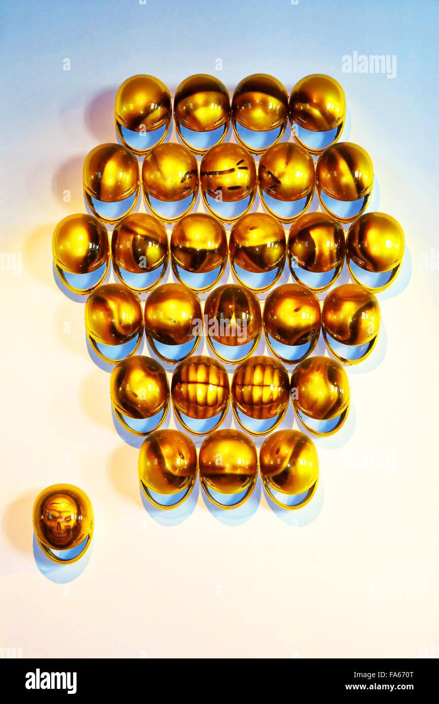 Malaga Spain Automovilistico De Malaga faces in gold crash helmets - Stock Image