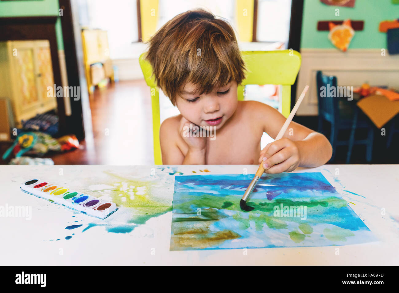 Boy painting with watercolors - Stock Image