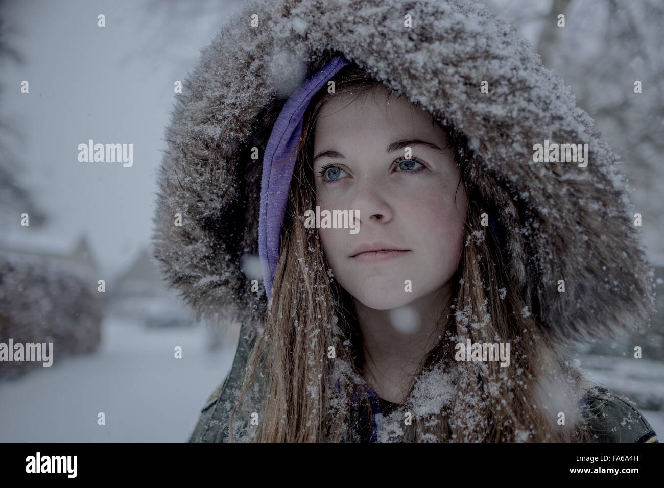 eca118523458 Teenage girl wearing a snow covered furry hooded parka Stock Photo ...