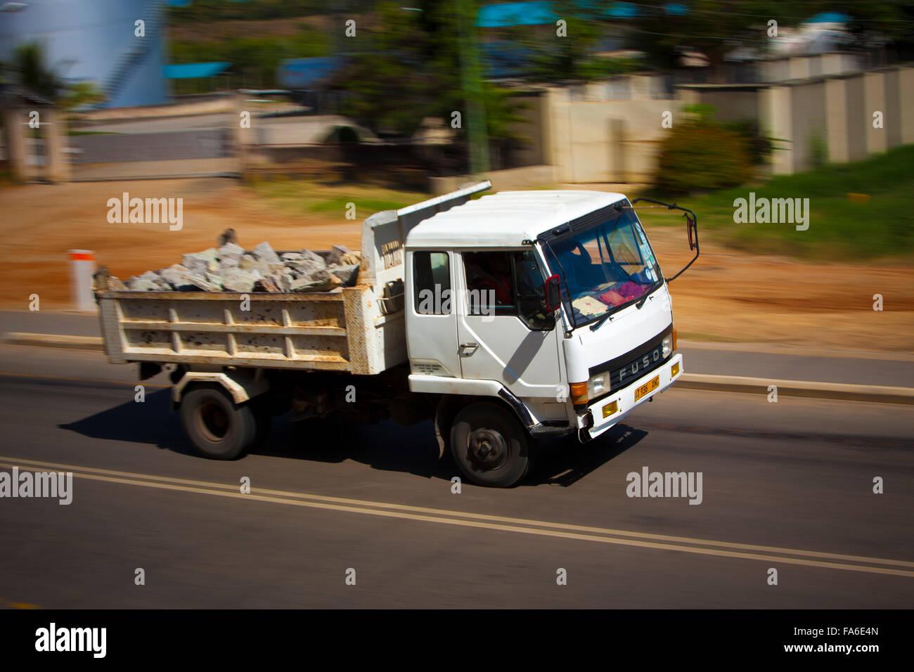 Traffic moves along the newly rehabilitated Tanga – Horohoro trunk road in Northeastern Tanzania. - Stock Image