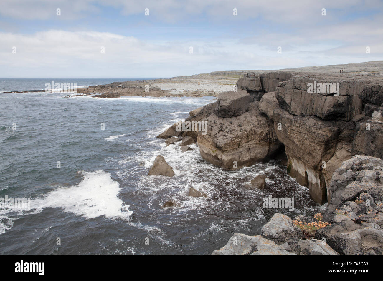 Tourists on the clifftops on the west coast of Ireland at Poulsallagh - part of the Wild Atlantic Way coastal route - Stock Image