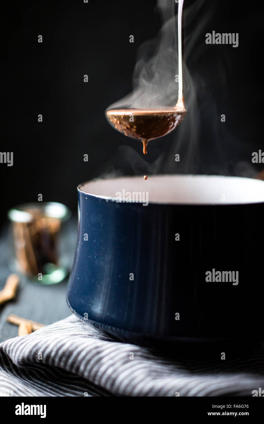 Dairy-free version of champurrado, almond milk forms the base for spiced hot chocolate thickened with masa harina, - Stock Image