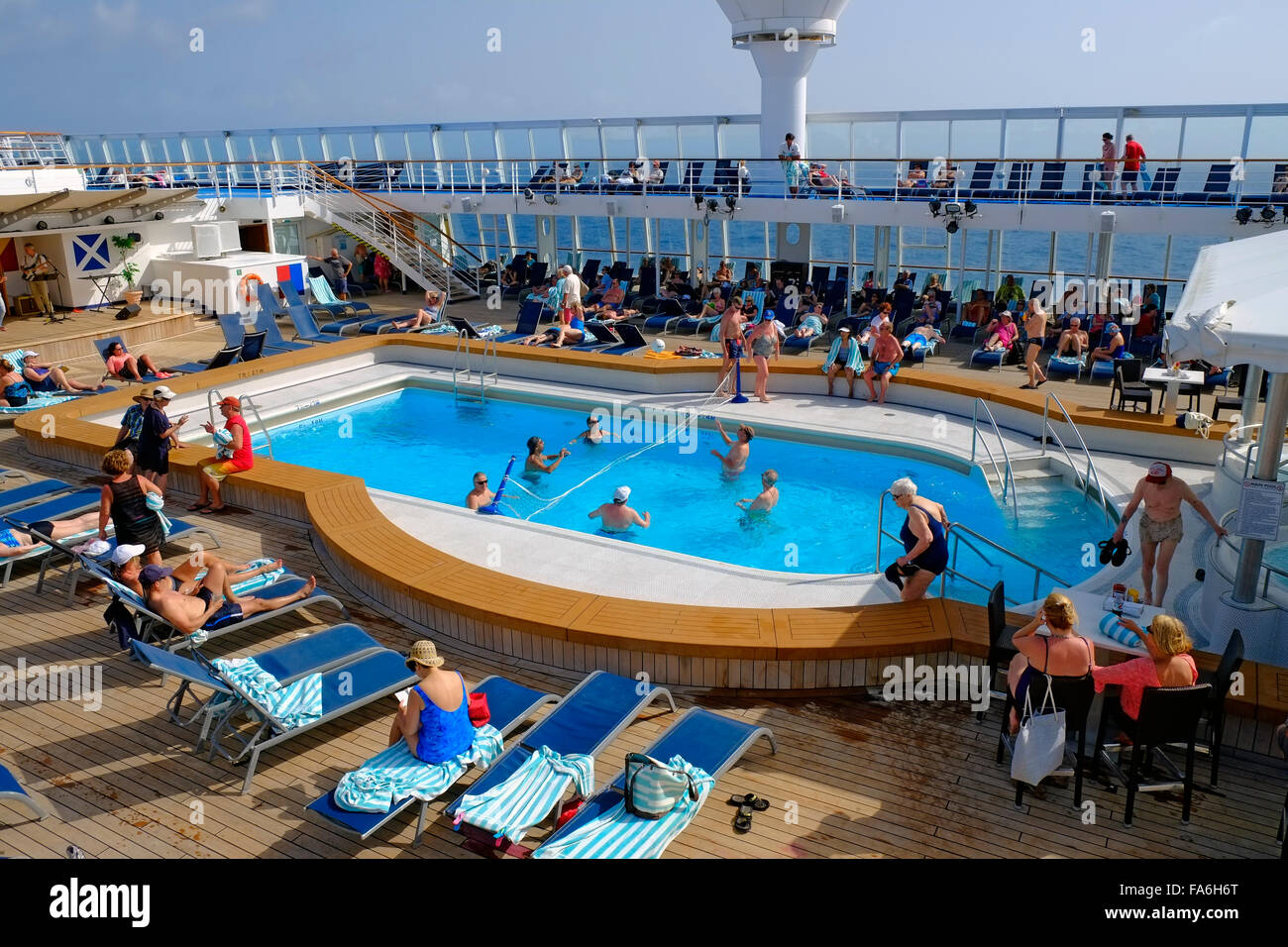 Swimming pool deck norwegian sun cruise ship stock photo 92343632 alamy for River cruise ships with swimming pool