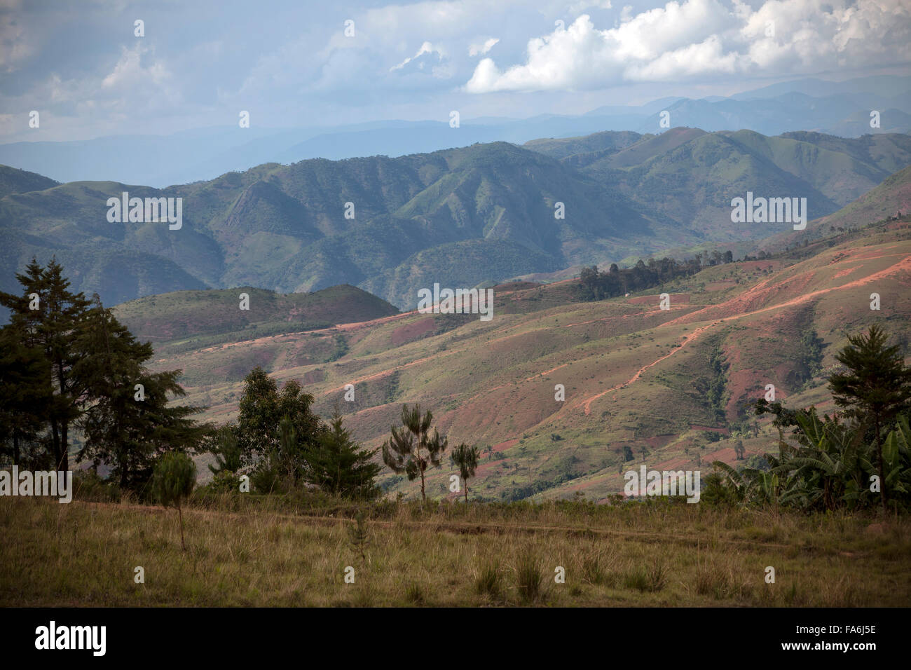 The Kungwe-Mahale Mountains rise above Kigoma Region in Western Tanzania. - Stock Image