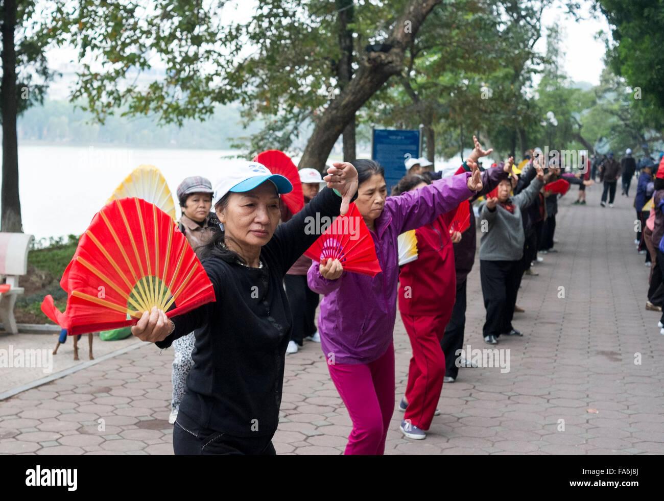 Public exercise class next to Hoan Kiem Lake, centre of Hanoi,Vietnam. - Stock Image