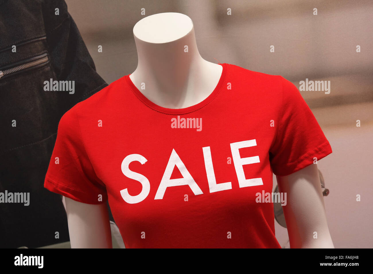 26f36a93c Sale printed on red T-shirt of a mannequin in a shop window Stock ...