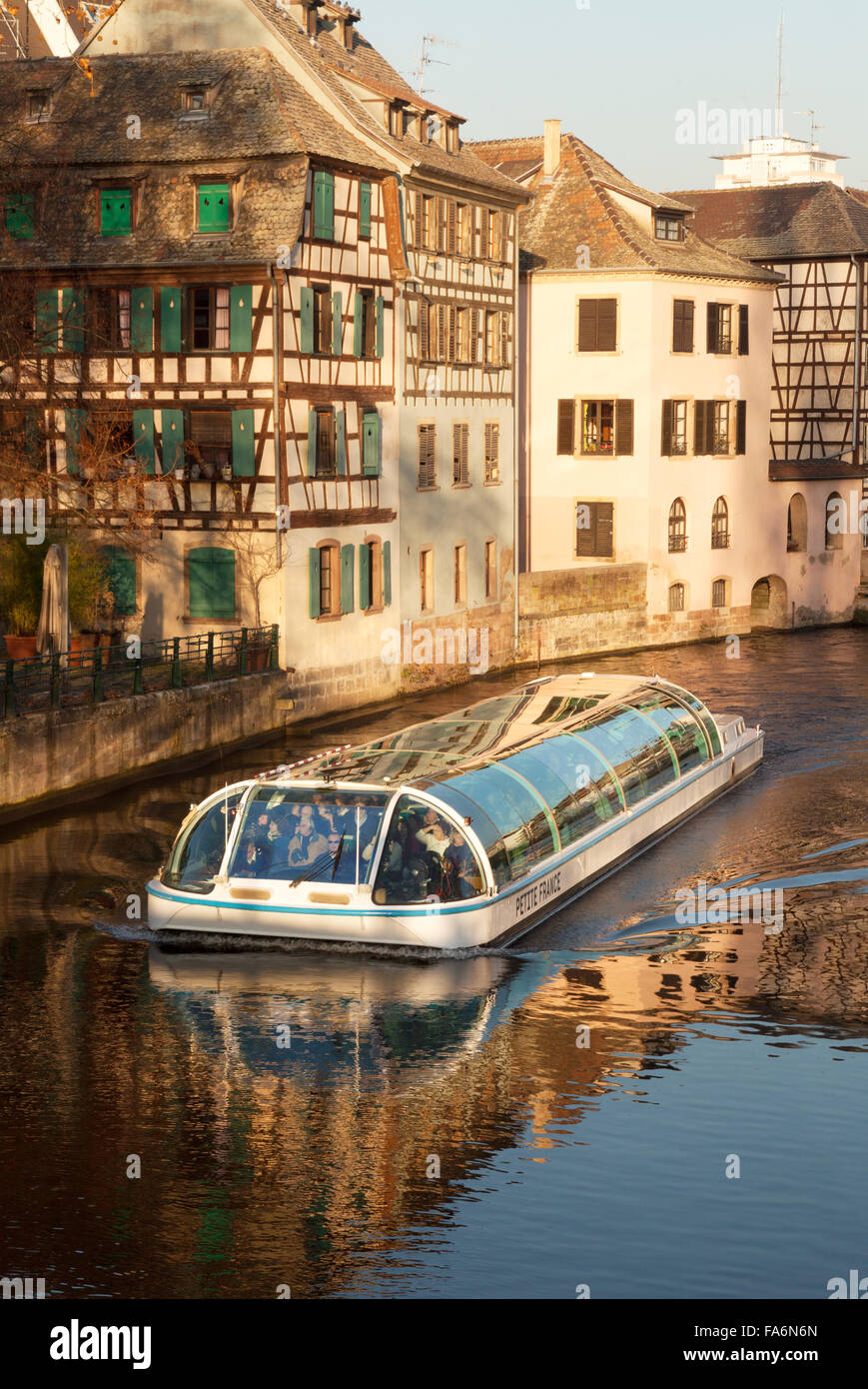 Early morning tourist boat tour on the River Ill, Petite France, Strasbourg, France Europe - Stock Image