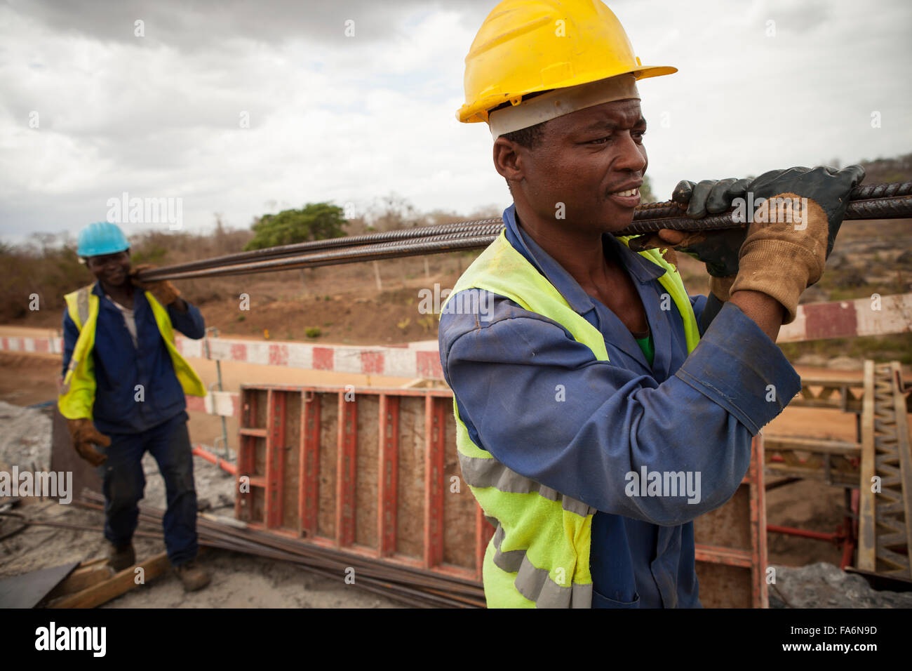Construction workers rehabilitate an aging bridge along the Namialo to Rio Lurio Road in Northern Mozambique, SE - Stock Image