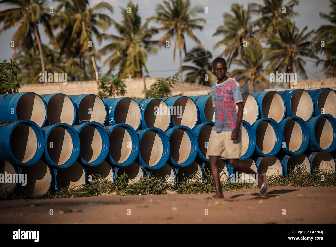 Water pipes await installation in Nampula, Mozambique. - Stock Image