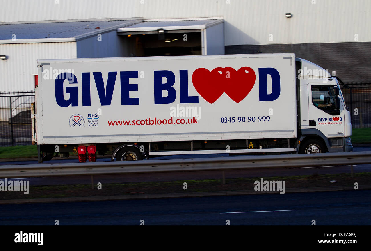 NHS 'Give Blood' Transfusion mobile unit lorry travelling along the Kingsway West Dual Carriageway in Dundee, - Stock Image