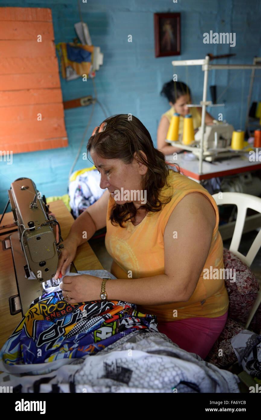 Seamstresses in Comuna 8 slum, Medellin, Antioquia Department, Colombia - Stock Image