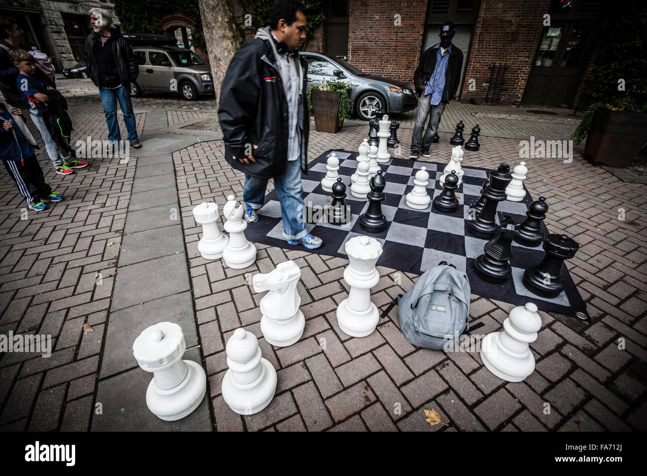 Men playing to an outdoor chess game, Seattle, Washington State - Stock Image