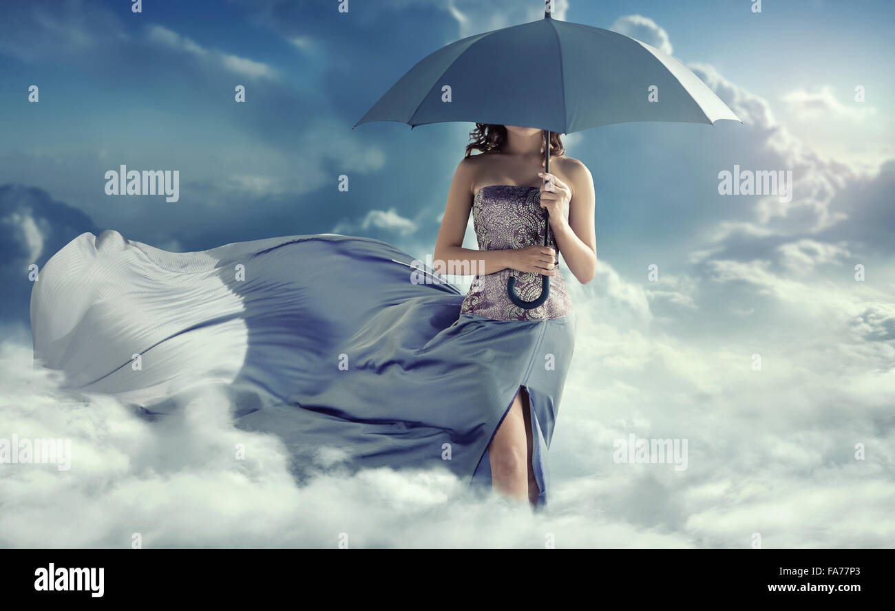 Attractive lady walking on the clouds - Stock Image