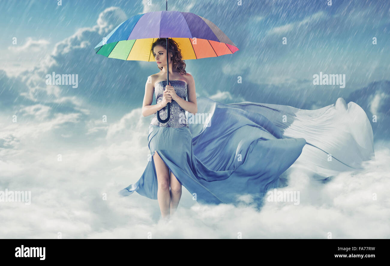 Pretty young woman during rainy weather - Stock Image