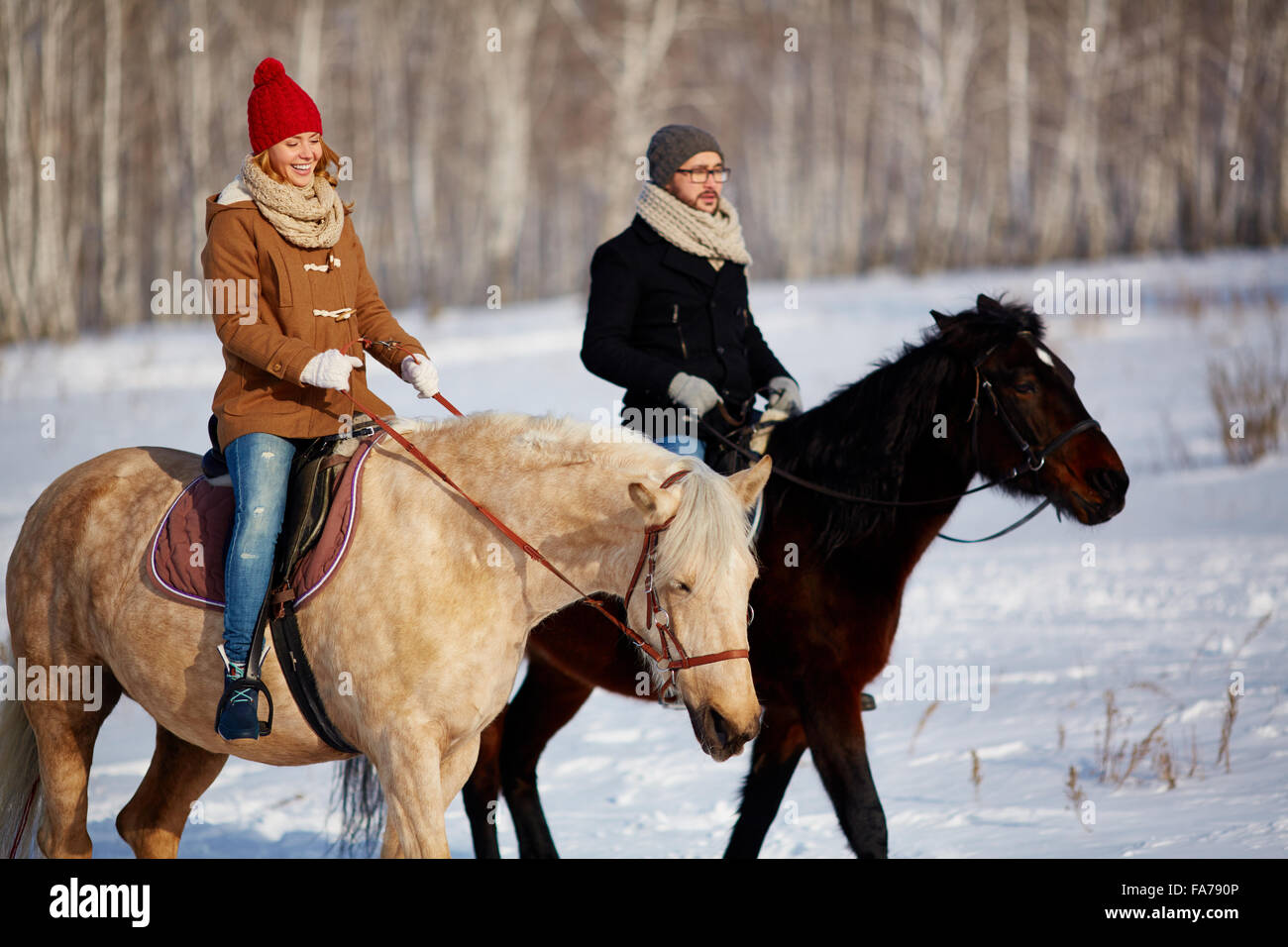 Couple Enjoying Horse Riding In Winter Day Stock Photo Alamy