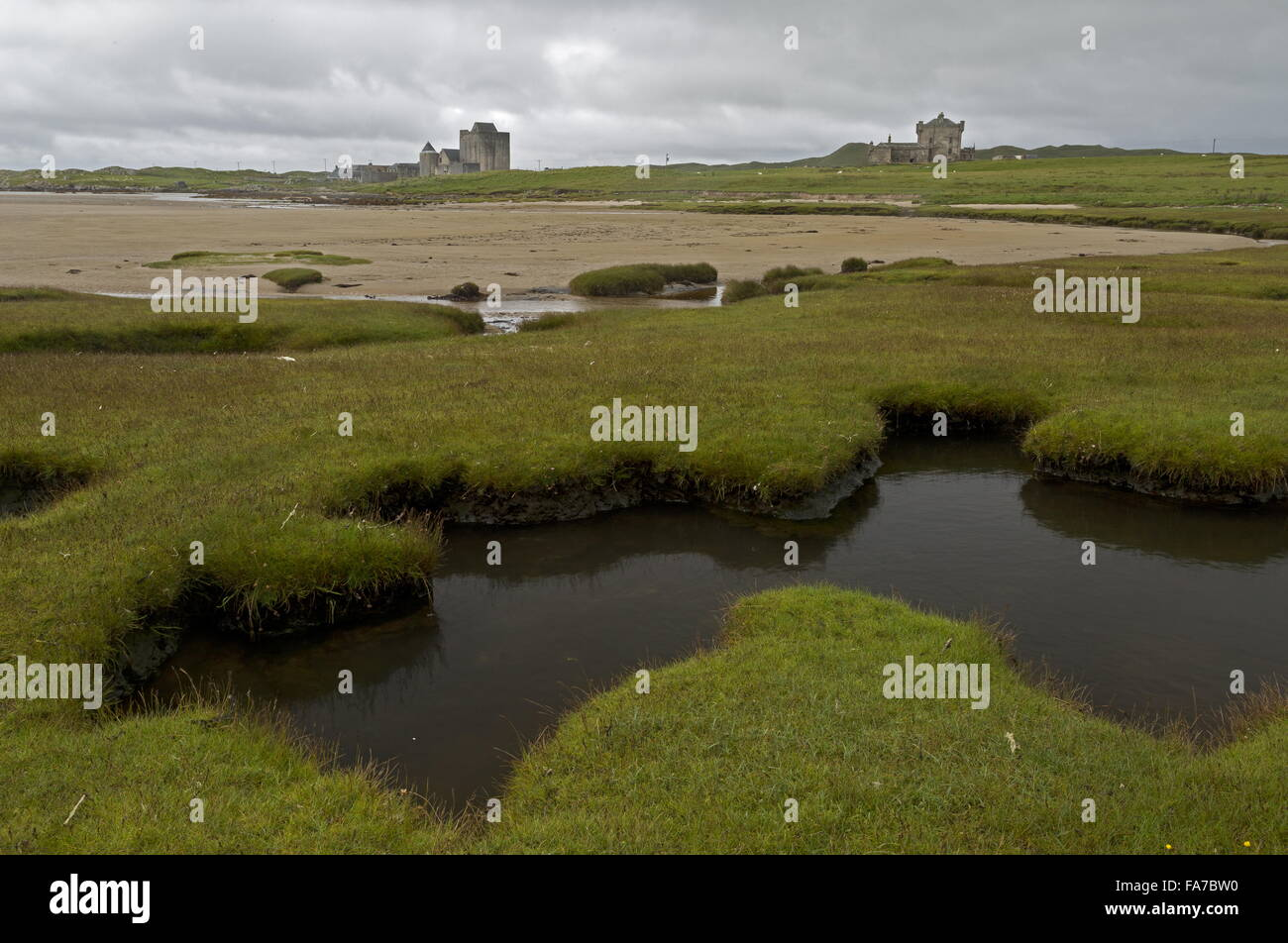 Looking across saltmarsh to the castles of Breachacha, the island of Coll, Inner Hebrides, Scotland. - Stock Image