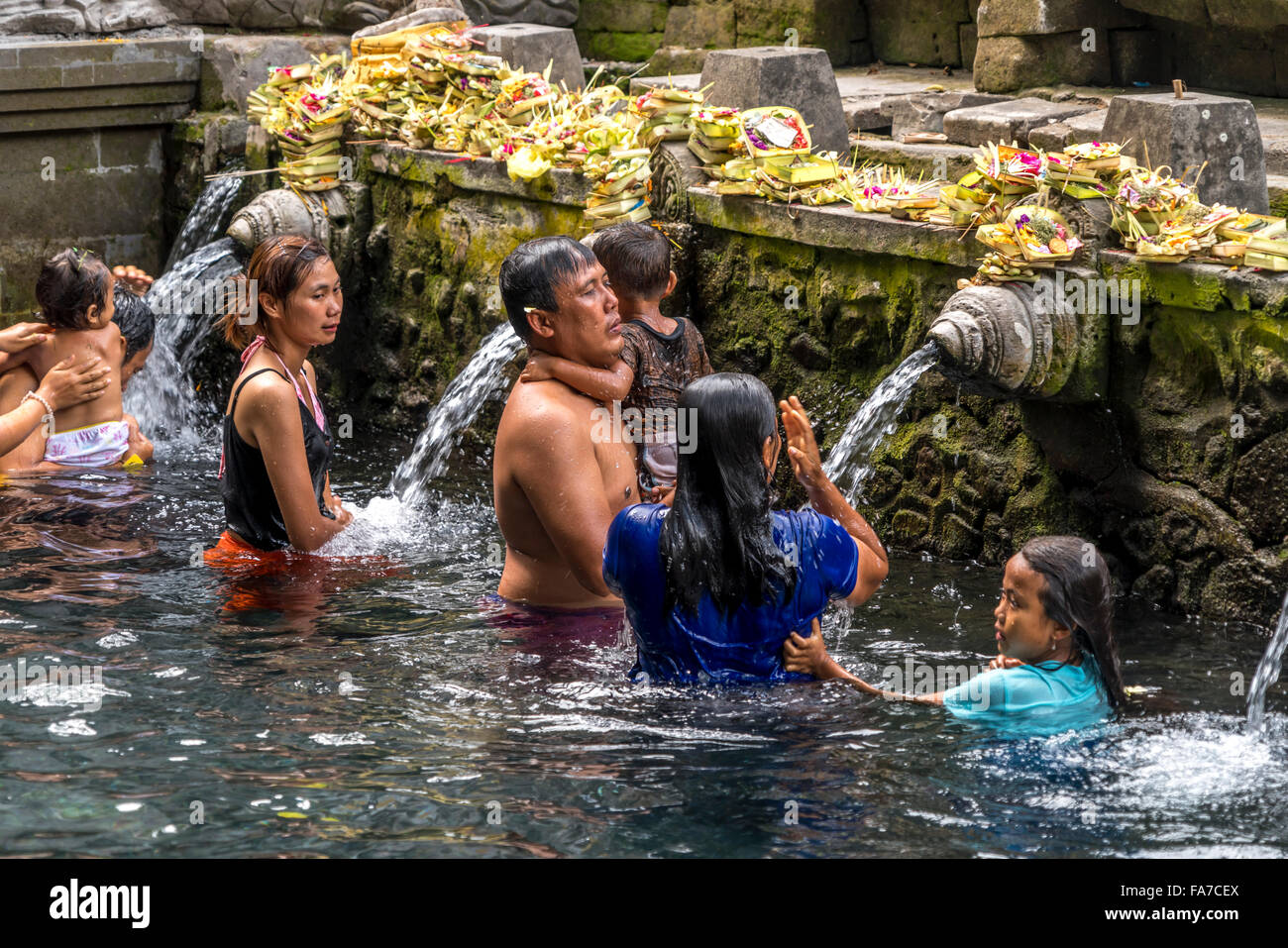 bathing structure with holy spring water of the Hindu water temple Tirta Empul near Ubud, Bali, Indonesia - Stock Image